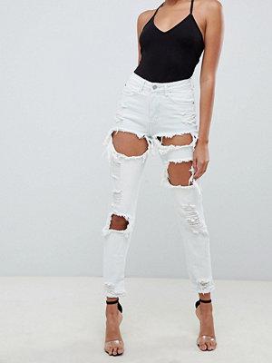 Missguided Blekta urtvättade mom-jeans