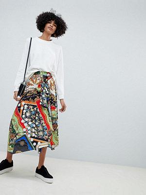 ASOS DESIGN Midi kjol med mixat sjal mönster