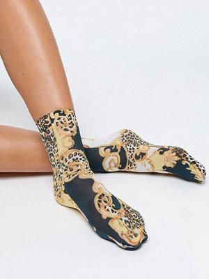 ASOS DESIGN Strumpor med kedje och leopardmönster
