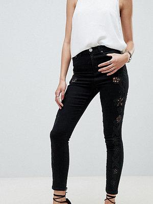 ASOS DESIGN Ridley Svarta skinny jeans med hög midja och cut-out detalj