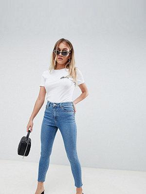ASOS Petite Ridley Stentvättat ljusblåa skinny jeans med hög midja Blå stentvätt