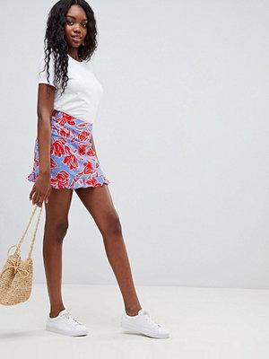 Glamorous Blommig kjol med volangfåll Blue red flo