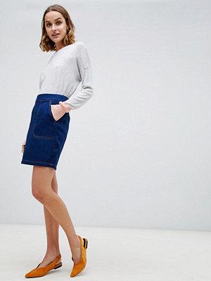 Warehouse Mellanblå minikjol i jeanstyg Rå