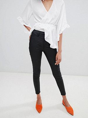 River Island Harper Svarta skinny jeans med blank yta och hög midja
