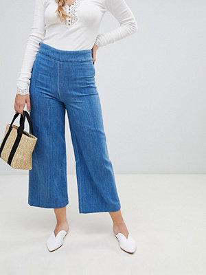 Free People Clean Jeans med vida ben