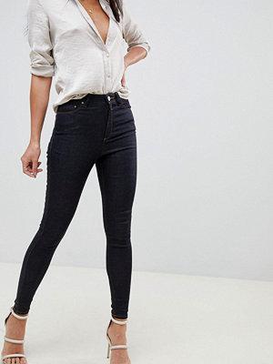 ASOS DESIGN Ridley Indigotvättade jeans i skinny fit med hög midja Indigo