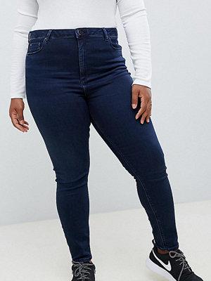 ASOS Curve Ridley Blåsvarta jeans med hög midja och extra smal passform Blacked blue wash