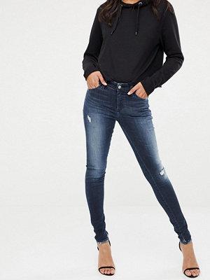 Diesel Slandy mellanhöga skinny jeans med slitna partier Darkwash