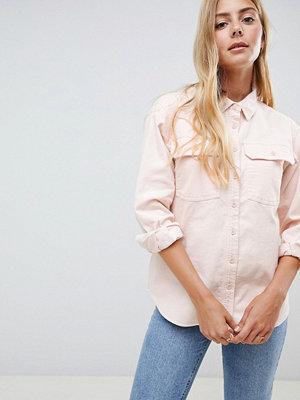 ASOS DESIGN Rosa manchesterskjorta. Blekrosa