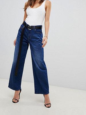 Diesel Jeans med vida ben och hög midja Medeltvätt