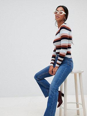 New Look Petite Utsvängda jeans Mellanblå