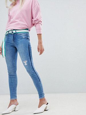 River Island Molly Mellanblå jeans med kontrasterande paneler och extra smal passform