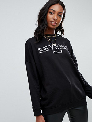 Missguided Tall Svart sweatshirt med Beverly Hills-slogan