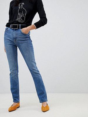 Warehouse Skulpterande skinny jeans i mellantvätt med hög midja Mellanljus tvätt