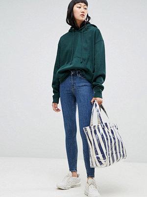 Weekday Body mellanblå skinny jeans med superstretch i ekologisk bomull Mellanblå