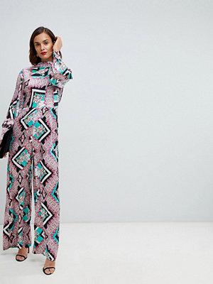 ASOS DESIGN Blommig jumpsuit med hög halsringning och blusärm