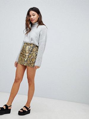 Bershka Glansig kjol med ormskinnsmönster och dragkedjor