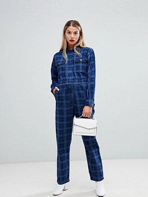 ASOS DESIGN Jeansoverall Blå tvätt