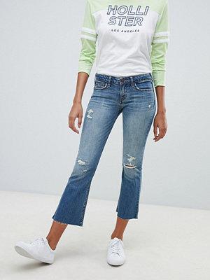 Hollister Jeans i kick flare-modell med slitna detaljer Mellantvätt med revor