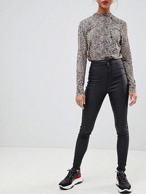 Noisy May Svarta skinny jeans med beläggning