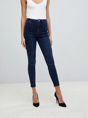 ASOS DESIGN Ridley Mörkblå skinny jeans med hög midja och rund knädetalj Mörkblå