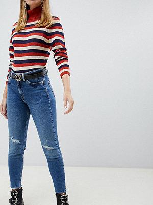 River Island Petite Slitna skinny jeans i mellantvätt Mid auth
