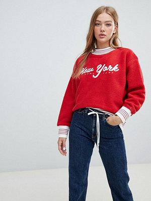 Tröjor - Tommy Jeans Sweatshirt i fleece med logga Samba