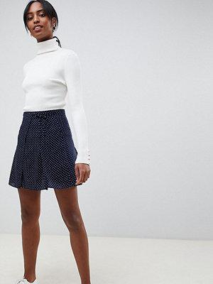 ASOS DESIGN Tall Prickig minikjol med omlottdesign Marinblå med prickar