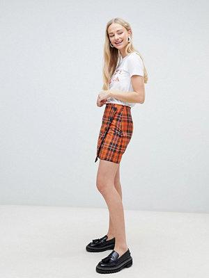 New Look Skotskrutig minikjol Rostfärgat