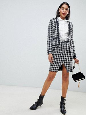 Morgan Hundtandsmönstrad asymmetrisk kjol med knapp fram Hundtandsmönstrad