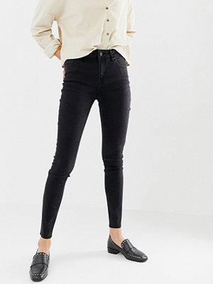 Only Pearl Skinny jeans med medelhög midja och råskuren kant