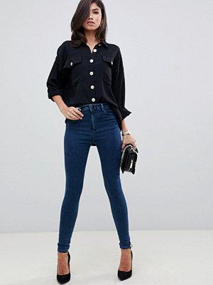 ASOS DESIGN Ridley Mörkblå skinny jeans med hög midja Dark green blue