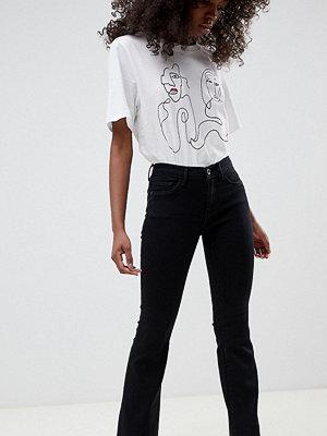 Only Petite Svarta utsvängda jeans