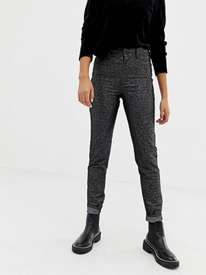 Cheap Monday Svarta glänsande jeans i ekologisk bomull med hög midja