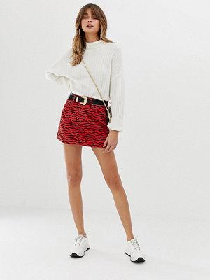 River Island Röd tigermönstrad minikjol i jeans