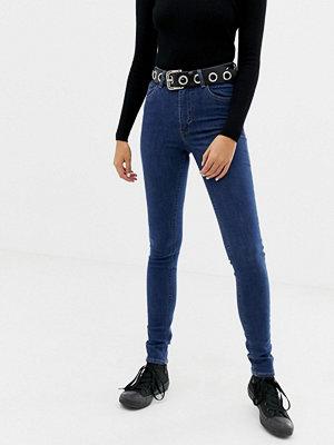 Cheap Monday Skinny jeans med stretch och hög midja i återvunnen och ekologisk bomull Skymningsblå