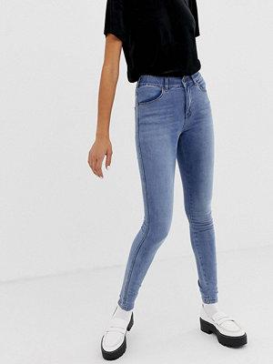 Dr. Denim Lexy Medelhöga jeans i skinny fit Ljus sten