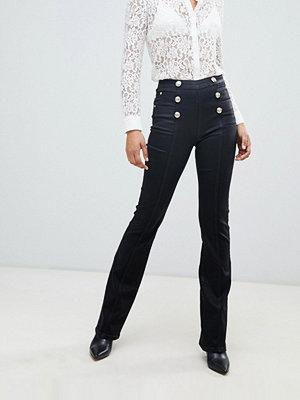 Morgan Svarta utsvängda jeans med hög midja och knappar