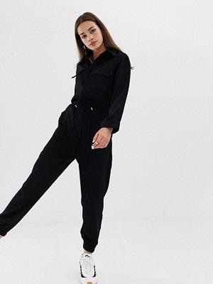 Bershka Jumpsuit med dragkedja framtill Marinblå