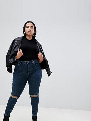 ASOS Curve Ridley Mörkblå skinny jeans med hög midja och revor på knäna London-blåtvätt