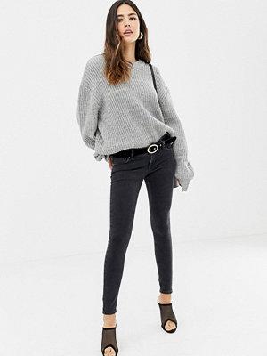 ASOS DESIGN Svarta skinny jeans med extremt låg midja och tvättad look Tvättad svart