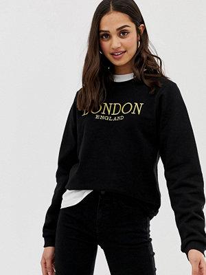 ASOS DESIGN London Guldbroderad sweatshirt i boyfriend-passform