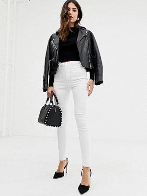 ASOS DESIGN Ridley Vita jeans i skinny fit med hög midja
