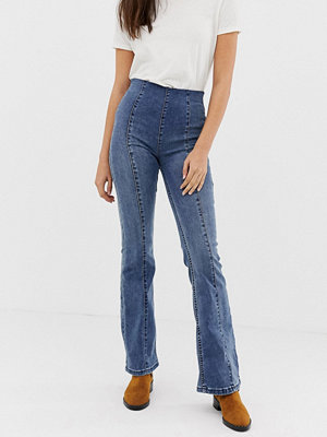 Free People Slim utsvängda jeans