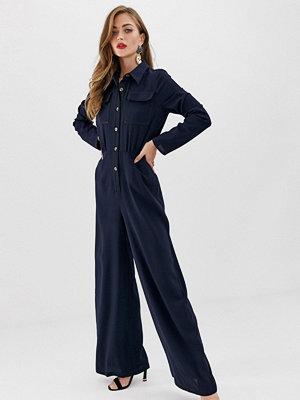 ASOS DESIGN Jumpsuit i skjortmodell med ficka framtill och dekorsöm