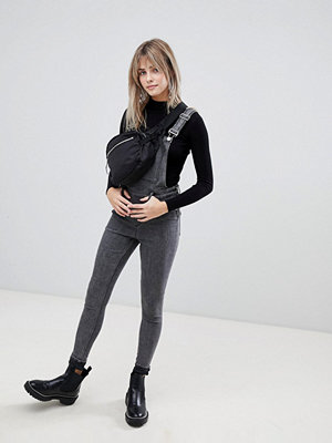Jumpsuits & playsuits - Cheap Monday Hängselbyxor i tajt modell