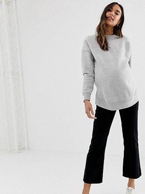 ASOS Maternity Egerton Svarta ankellånga utsvängda jeans med midjeband som sitter över magen