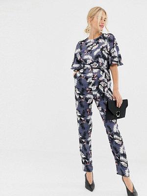 Uttam Boutique Blommig jumpsuit med korta ärmar