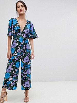 ASOS DESIGN Blommig jumpsuit i empirestil med utsvängd ärm