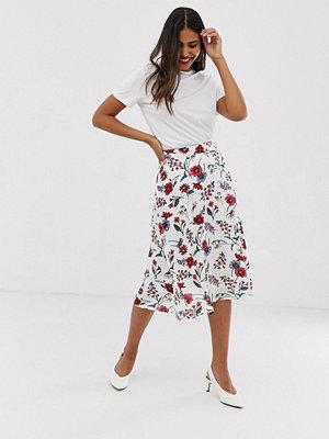 Vila Blommig kjol Vit bas med blommönster